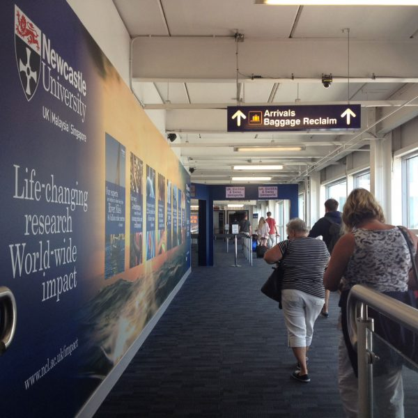 Large Wall Wrap, International Arrivals Corridor, Newcastle Airport Advertising, Newcastle University