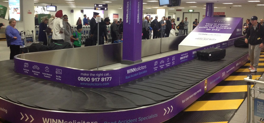 Winn Solicitors, Newcastle International Airport, Domestic Baggage Reclaim, Baggage Carousel Wrap